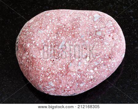 Pebble Of Pink Arkose Sandstone On Dark Background