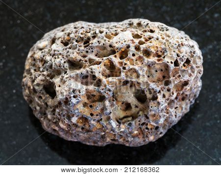 Tumbled Brown Pumice Stone On Dark Background