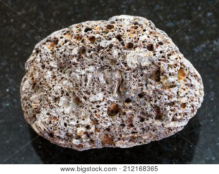 Pebble Of Brown Pumice Stone On Dark Background