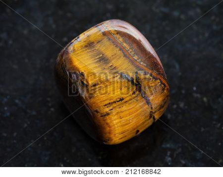 Polished Tiger-eye Gem Stone On Dark Background