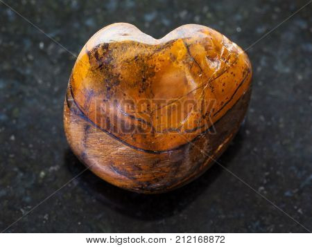 Polished Tiger-eye Stone On Dark Background