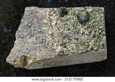 Rough Crystals Of Epidote On Rock On Dark