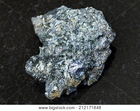 Molybdenite Crystal In Rough Glaucophane On Dark