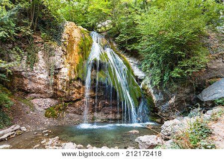 Ulu-uzen River With Djur-djur Waterfall In Autumn