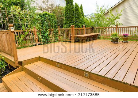 Wooden deck of family home at summer.