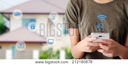 Woman using smart phone as smart home remote control mobile app over blurred house background banner smart home device wireless network the internet of things concept