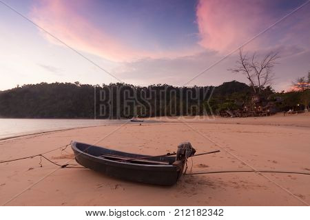 Little boat in beach at Twilight time.