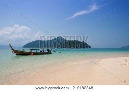 Traditional thai longtail boat with white beach at Ranong sea Thailand