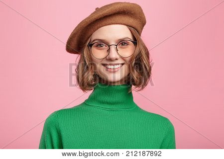 Charming Delightful Smiling Woman Dressed In Retro Clothes, Has Appealing Appearance, Demonstrates P