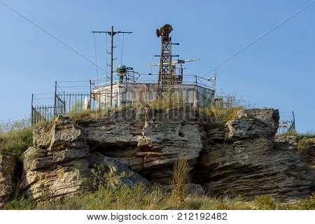 CAPE KALIAKRA BULGARIA - AUGUST 23 2017: Border outpost and lighthouse. A military object on top of a cliff.