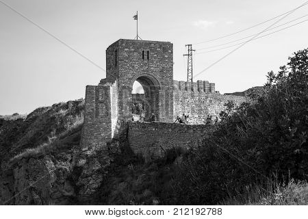 CAPE KALIAKRA BULGARIA - AUGUST 23 2017: The medieval fortress of Kaliakra. The preserved part of the fortress wall and the watchtower. Black and white.
