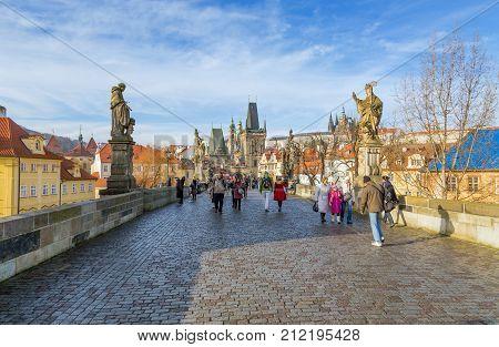 PRAGUE, CZECH REPUBLIC - DECEMBER 26, 2013. Charles Bridge in Prague, Czech Republic on December 26, 2013. Charles Bridge is a popular tourist attraction in Prague.