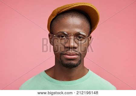 Strict Serious Man With Dark Healthy Skin, Wears Trendy Cap And Glasses, Has Confident Expression, S
