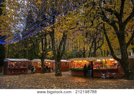 CHIANCIANO TEMRE, ITALY - NOVEMBER 4, 2017: The park of Acqua Santa with the Christmas market in Chianciano Terme at winter time