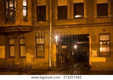 Old shabby building at night in the center Saint Petersburg (between 1924 and 1991 named Leningrad). St. Petersburg was founded by Tsar Peter the Great on 1703 and was the capital of imperial Russia.