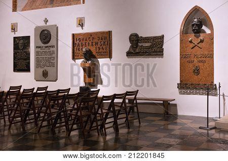 WARSAW, POLAND - JANUARY 01, 2016: Interiors of the catholic St. John's Archcathedral with memorial plates of famous personalities. Among them are Pilsudski Slowacki Paderewski Dmowski Grabski.