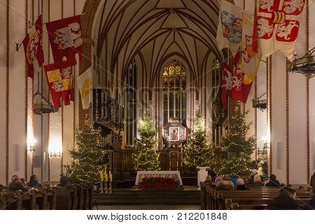 WARSAW, POLAND - JANUARY 01, 2016: Main altar of the gothic St. John's Archcathedral in Christmas decoration. Originally built in the XIV century but in 1944 was ruined and rebuilt after the war.