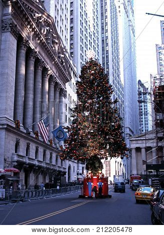 NEW YORK, USA - DECEMBER 8, 1994 - New York Stock Exchange in Wall Street with a Christmas Tree in the road. New York USA, December 8, 1994.