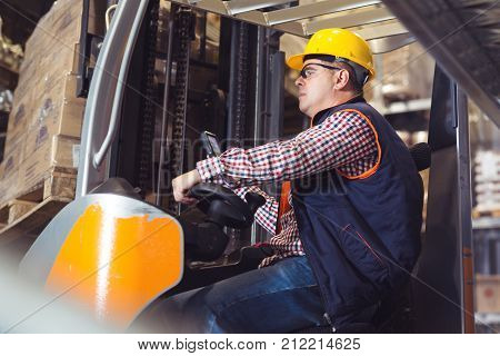 Working hard. Warehouse young workers.Close up picture