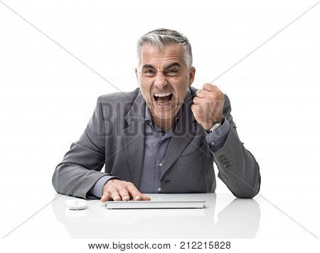 Angry Businessman Working With A Computer