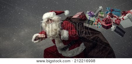 Santa Claus Running And Delivering Gifts