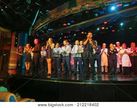 Venice, Italy - June 06, 2015: The greeting team at theater at cruise ship Splendour of the Seas by Royal Caribbean International at port Venice, Italy on June 06, 2015. The interior of theater