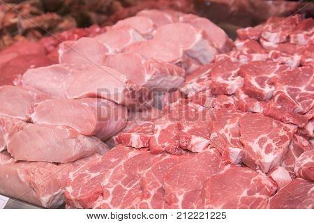 Close up of various meat in a supermarket. Raw meat at butcher shop