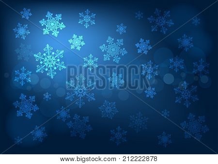 Abstract dark blue winter background with snowflakes