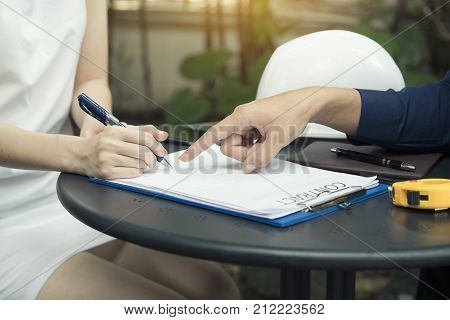 A businesswoman is negotiating a business deal or contracting and signing a contract business negotiation concept
