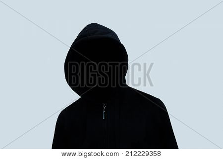 the black man with no face on a blue background. black silhouette of guy. Anonymous.