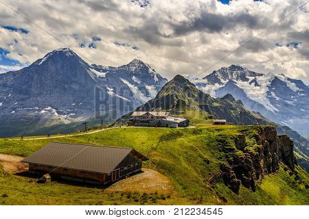 Stunning view on worldfamous mountain trio Eiger Monch and Jungfrau with Tschuggen in the foreground. Seen from Mannlichen in the Bernese Alps in summer. Wengen Bernese Oberland Switzerland