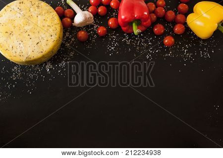 Food assortment with cheese and vegetables, top view free space. Quality sort of Caciotta with cherry tomato, local market and italian cuisine concept