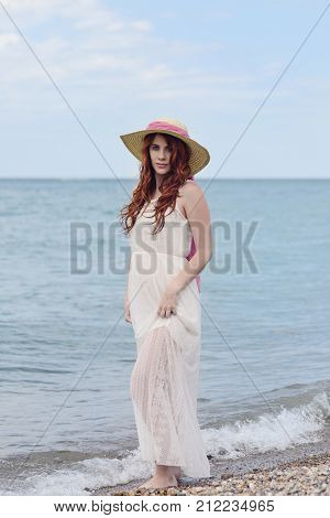 redhead woman wearing white dress at beach