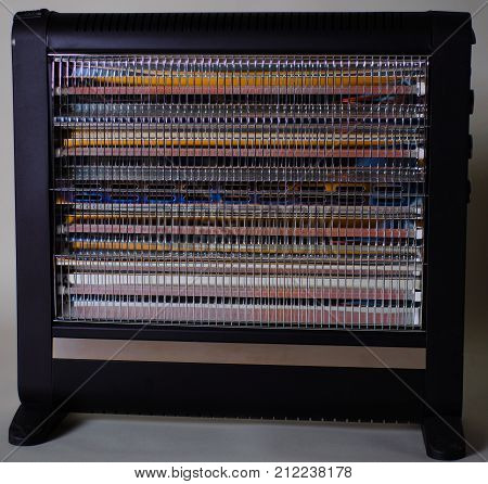 Halogen Or Infra Heater In Action Against Gray Background
