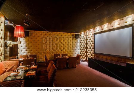Moscow, Russia - April 27, 2011 - Restaurant interior with subdued lights and cinema screen