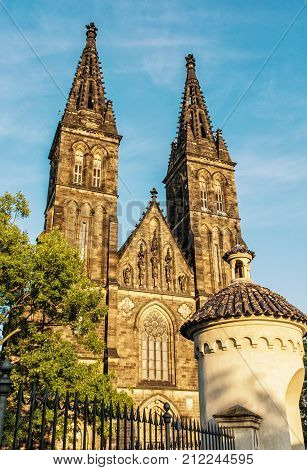 Beautiful basilica of Saint Peter and Saint Paul Vysehrad Prague Czech republic. Sunset photo. Religious architecture. Travel destination. Yellow photo filter.