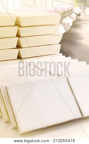 Blank paper boxes white package stacked on the white table with restaurant background for mock up fast food or products and logo branding.