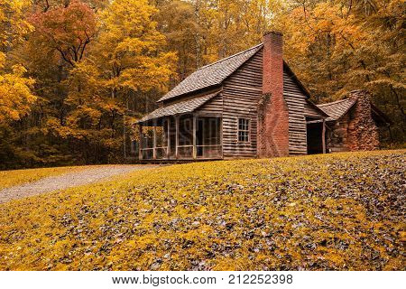 Autumn at the Henry Whitehead Cabin in Great Smoky Mountains National Park Tennessee. Note: This a public historic structure located within Great Smoky Mountains National Park poster