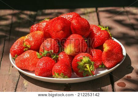 Fresh Strawberry on wooden table. Stock photo.