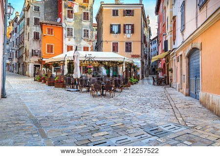 Spectacular stone paved street with colorful houses and typical street cafe bar Rovinj old town, Istria region, Croatia, Europe