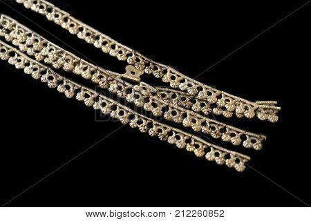Aliseda Spain - October 29 2017: Undulating festoon piece of tartessos treasure gold of Aliseda. Replica currently kept at Interpretation Centre of Aliseda Caceres Spain