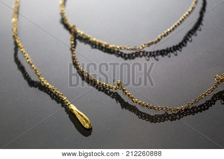 Aliseda Spain - October 29 2017: Golden necklace piece of tartessos treasure of Aliseda. Replica currently kept at Interpretation Centre of Aliseda Caceres Spain