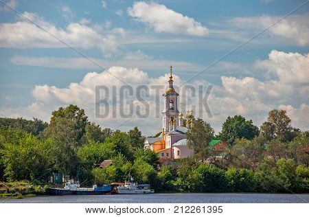 Traditional russian church in small town on river bank