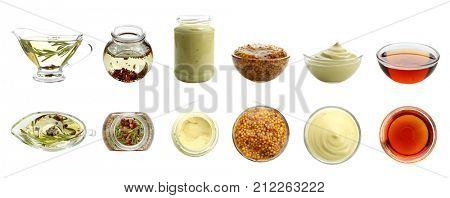 Delicious dressings for salad on white background