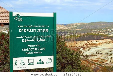 BEIT-SHEMESH, ISRAEL - SEPTEMBER 23, 2017: Information pointer of Avshalom Cave, also known as Soreq Cave, a large stalactites cave near Beit-Shemesh in central Israel