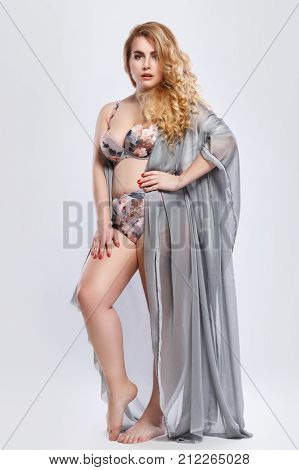 Beautiful Plus Size Model Wearing Lingerie And Piece Fabric