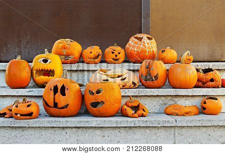 Halloween is finished, pumpkins are defaced, scary scene.