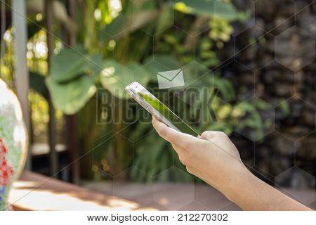 Hand Hold Smart Phone And Sent Or Receive Email. Email Icon Over Phone. Hexagon Background