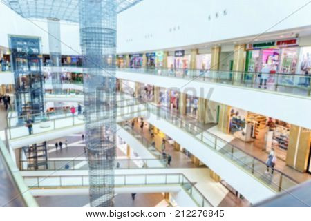 Abstract mall, multilevel shopping center, blurred focus