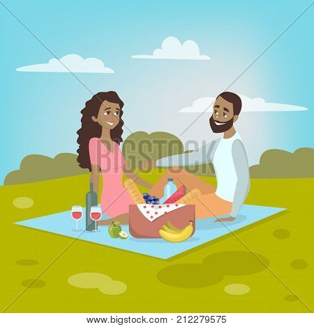 Couple at picnic. African american couple sitting in park on blanket with food.